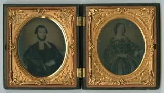 PAIR OF AMBROTYPES, CASED TOGETHER, FEATURING A MINISTER AND HIS WIFE]. Photographica