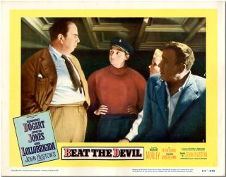 Original color studio lobby card for BEAT THE DEVIL. Truman Capote, John Huston, screenwriters